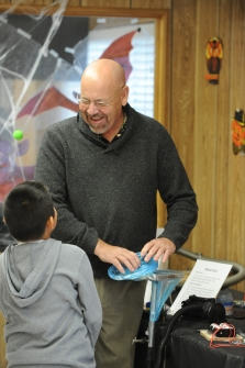 Photo by Bill Schaefer Con Jensen, left, a member of the Pocatello Kiwanis Club, demonstrates one of the air pressure experiments a student from Wilcox Elementary School.