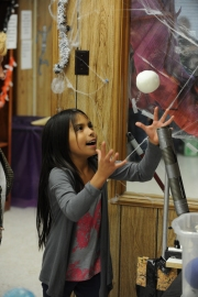 Photo by Bill Schaefer Angelique Matalongo, 7, second grade student at Ellis Elementary school laughs at the air pressure tube demonstration station.
