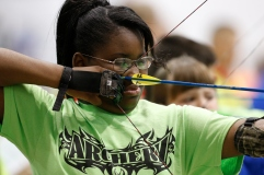 Briana Perkins takes aim in the first round of the On Target with Kiwanis Archery Shoot on Saturday, Nov. 9, 2013 in Lawton, Okla. Photo by Steve Sisney