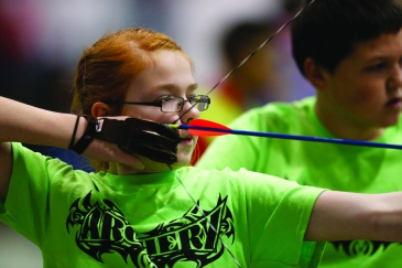 Archer Tiffany Snow shoots during the On Target with Kiwanis Archery Shoot on Saturday, Nov. 9, 2013 in Lawton, Okla. Photo by Steve Sisney