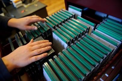 PHOTO: BARTOSZ KRUPA/EAST NEWS OWINSKA, 30/01/2013. OSRODEK OPIEKUNCZO - WYCHOWAWCZY DLA DZIECI NIEWIDOMYCH W MIEJSCOWOSCI OWINSKA. N/Z: SZKOLNA BIBLIOTEKA. ZBIOR AUDIOBOOKOW NA PLYTACH CD. Owinska, Poland 30/01/2013 The school for blind children in Owinska. In the picture: audiobooks collection in a school library.