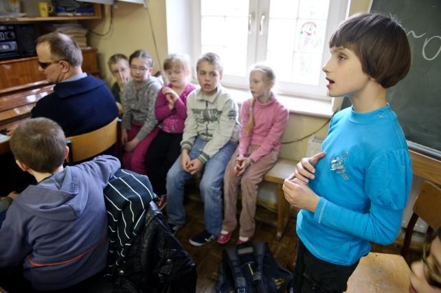 """PHOTO: BARTOSZ KRUPA/EAST NEWS OWINSKA, 30/01/2013. OSRODEK OPIEKUNCZO - WYCHOWAWCZY DLA DZIECI NIEWIDOMYCH W MIEJSCOWOSCI OWINSKA. ZAJECIA MUZYCZNE POD OPIEKA PANA HENRYKA WEREDY - NIEWIDOMEGO NAUCZYCIELA MUZYKI ORAZ KIEROWNIKA SZKOLNEGO CHORU """"DZIECI PAPY"""" Owinska, Poland 30/01/2013 The school for blind children in Owinska. Music lesson conducted by blind music teacher Henryk Wereda who is also """"Dzieci Papy"""" choir conductor. In the picture: Basia is singing."""