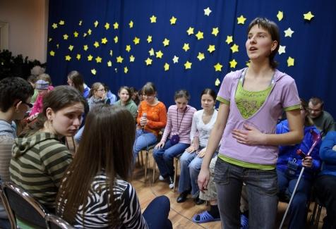 """PHOTO: BARTOSZ KRUPA/EAST NEWS OWINSKA, 29/01/2013. OSRODEK OPIEKUNCZO - WYCHOWAWCZY DLA DZIECI NIEWIDOMYCH W MIEJSCOWOSCI OWINSKA. N/Z: PROBA SZKOLNEGO CHORU """"DZIECI PAPY"""" POD PRZEWODNICTWEM NIEWIDOMEGO NAUCZYCIELA MUZYKI, PANA HENRYKA WEREDY. MONIKA SPIEWA GORALSKA PIESN LUDOWA. Owinska, Poland 29/01/2013 The school for blind children in Owinska. In the picture: """"Dzieci Papy"""" school choir rehearsal conducted by blind music teacher mr. Henryk Wereda. Monika is singing folk songs."""