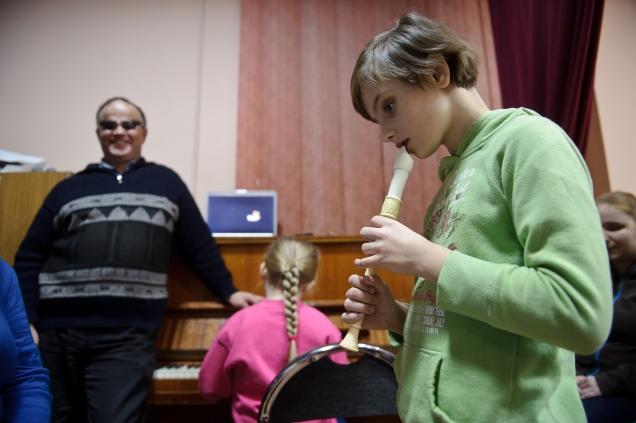 """PHOTO: BARTOSZ KRUPA/EAST NEWS OWINSKA, 29/01/2013. OSRODEK OPIEKUNCZO - WYCHOWAWCZY DLA DZIECI NIEWIDOMYCH W MIEJSCOWOSCI OWINSKA. N/Z: PROBA SZKOLNEGO CHORU """"DZIECI PAPY"""" POD PRZEWODNICTWEM NIEWIDOMEGO NAUCZYCIELA MUZYKI, PANA HENRYKA WEREDY. BASIA GRA NA FLECIE. Owinska, Poland 29/01/2013 The school for blind children in Owinska. In the picture: """"Dzieci Papy"""" school choir rehearsal conducted by blind music teacher mr. Henryk Wereda. Basia is playing the flute."""