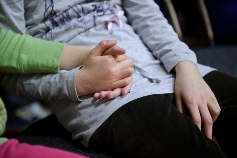 """PHOTO: BARTOSZ KRUPA/EAST NEWS OWINSKA, 29/01/2013. OSRODEK OPIEKUNCZO - WYCHOWAWCZY DLA DZIECI NIEWIDOMYCH W MIEJSCOWOSCI OWINSKA. N/Z: PROBA SZKOLNEGO CHORU """"DZIECI PAPY"""" POD PRZEWODNICTWEM NIEWIDOMEGO NAUCZYCIELA MUZYKI, PANA HENRYKA WEREDY. BASIA I NAIDA TRZYMAJA SIE ZA RECE. NAJMLODSZE DZIECI NAJCZESCIEJ W TEN SPOSOB ZASPOKAJAJA WZAJEMNIE POTRZEBE KONTAKTU Z INNA OSOBA. Owinska, Poland 29/01/2013 The school for blind children in Owinska. In the picture: """"Dzieci Papy"""" school choir rehearsal conducted by blind music teacher mr. Henryk Wereda. Basia and Naida are holding each other hands. This is the way, the youngest children fulfill their need of closeness to another human being."""