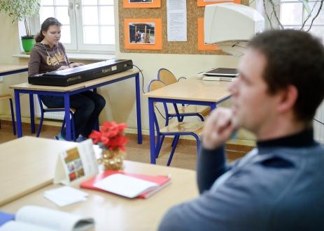 PHOTO: BARTOSZ KRUPA/EAST NEWS OWINSKA, 29/01/2013. OSRODEK OPIEKUNCZO - WYCHOWAWCZY DLA DZIECI NIEWIDOMYCH W MIEJSCOWOSCI OWINSKA. N/Z: UCZENNICA GRA I SPIEWA KOLEDY NA LEKCJI RELIGII Owinska, Poland 29/01/2013 The school for blind children in Owinska. In the picture: school girl is playing and singing carols during religion lesson.