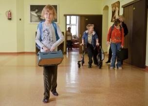 PHOTO: BARTOSZ KRUPA/EAST NEWS OWINSKA, 29/01/2013. OSRODEK OPIEKUNCZO - WYCHOWAWCZY DLA DZIECI NIEWIDOMYCH W MIEJSCOWOSCI OWINSKA. N/Z: NAIDA NIESIE SWOJA MASZYNE DO PISANIA Owinska, Poland 29/01/2013 The school for blind children in Owinska. In the picture: Naida with her Braile typewriter.