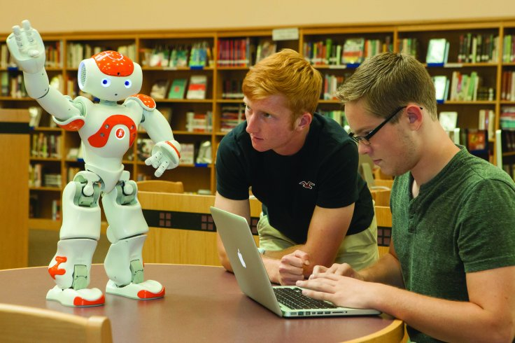 Programmers with robots used with special needs students