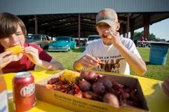 Austin Adams and Chris Schere feast on crawfish during the Kiwanis Crawfish Boil Cedar at Creek Lake Tx 050716 © 2016 Jaime R. Carrero/Carrero Photography