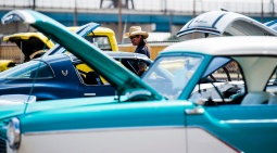 A man looks at vehicles at the car show, a part of the Cheyenne Kiwanis Rib Fest, Sunday, Aug. 16, 2015, in Cheyenne, WY. The festival included a rib competition, car show, and live music.