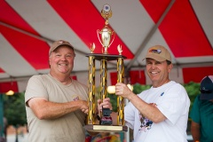 """Joe Alexander of Rasta Joe's BBQ Inc receives a trophy from Kiwanian Chuck Tyler for """"people's choice"""" at the Cheyenne Kiwanis Rib Fest Sunday, Aug. 16, 2015, in Cheyenne, WY. The festival included a rib competition, car show, and live music."""