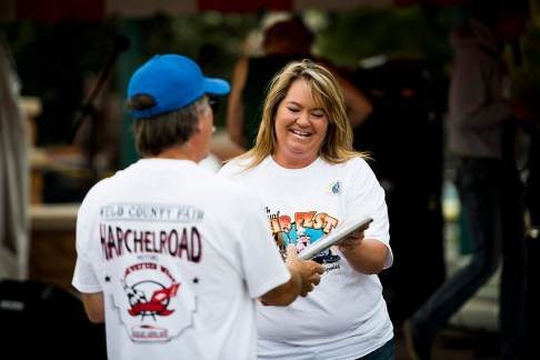 Kiwanian Jennifer Thayer hands out awards for the car show, a part of the Cheyenne Kiwanis Rib Fest, Sunday, Aug. 16, 2015, in Cheyenne, WY. The festival included a rib competition, car show, and live music.