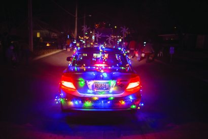 "A car in the parade at the Kiwanis Holiday Lights at Sibley Park in Mankato, Minn., on Friday, Nov. 29, 2013. The Kiwanis Holiday Lights feature over one million LED lights decorating trees, fences and buildings in the park. New this year is the Mary Dotson Skating Rink, which will feature synthetic ice, enabling skaters to enjoy the rink regardless of the weather. ""Last year we were thrilled to have over 100,000 visitors. This year we're planning to further expand the event by adding more lights and lighted displays,"" said Scott Wojcik, Kiwanis Holiday Lights President. Photo by Ackerman + Gruber"