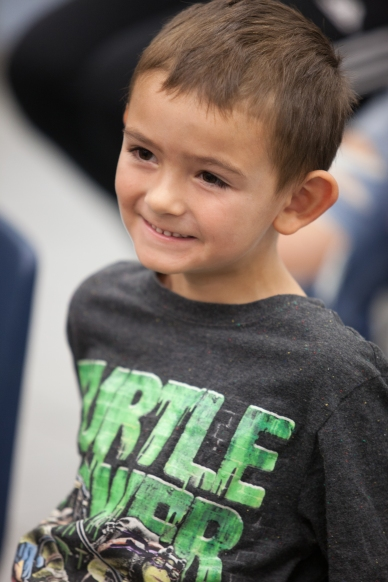 Fairglen Elementary School student Johnny Gurich tries on shoes during the Kiwanis of Rockledge shoe distribution in Cocoa, Florida on Thursday, November 10, 2016.