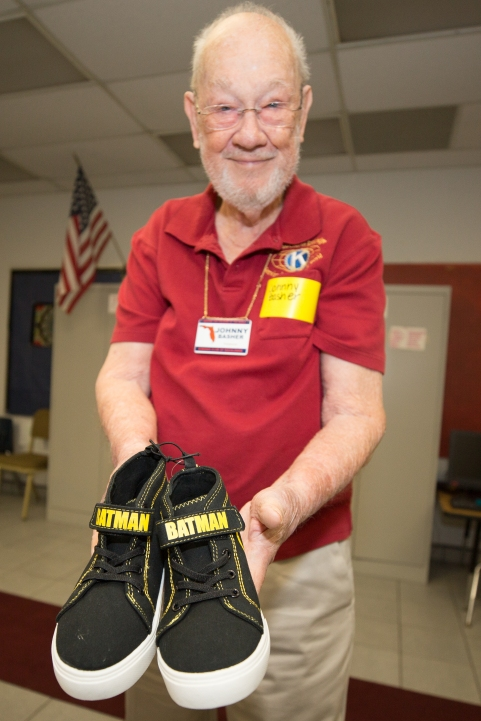 Kiwanis of Rockledge members Jonny Basher holds a pair of brand new shoes to be given to a needy student at Fairglen Elementary School in Cocoa, Florida on Thursday, November 10, 2016.