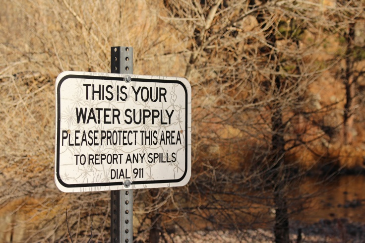"""This is your water supply "" sign near river states that the area must be protected."