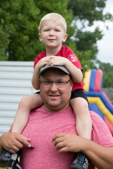 Cooper Flick, 5, sits on top of his dad Mark Flick's shoulders during the Ontario Kiwanis Kids Free Day at the Kiwanis Children's Animal Farm at Canatara Park on Saturday, July 8, 2017 in Sarnia, Ontario.