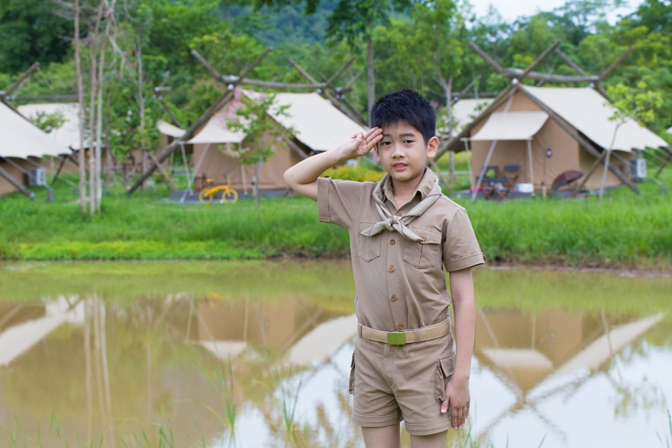boy scout, a Thai Asian boy scout in uniform with cheerful smile