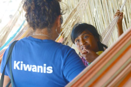 A girl from the Wayuu indigenous etnia talks with a member of Kiwanis Foundation during a Christmas event where members of Kiwanis Foundation gave away gifts to Wayuu kids at the Manhanaim Rancheria in Cabo de la Vela, Guajira department, Colombia, on December 23, 2017. Photo by Joaquin Sarmiento
