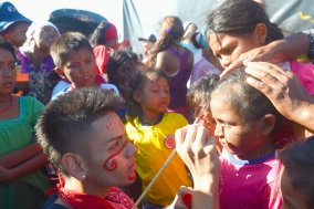 Boys from the Wayuu indigenous etnia get their facs painted by a volunteers at a Christmas event where members of Kiwanis Foundation gave away gifts to Wayuu kids at the Manhanaim Rancheria in Cabo de la Vela, Guajira department, Colombia, on December 23, 2017. Photo by Joaquin Sarmiento