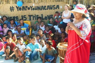 Trinidad from the Wayuu indigenous etnia gives a speech at a Christmas event where members of Kiwanis Foundation gave away gifts to Wayuu kids at the Manhanaim Rancheria in Cabo de la Vela, Guajira department, Colombia, on December 23, 2017. Photo by Joaquin Sarmiento