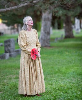 Rebecca Morgan, portraying Agnes Miller Furman, looks out over the cemetery waiting for the next group to arrive.